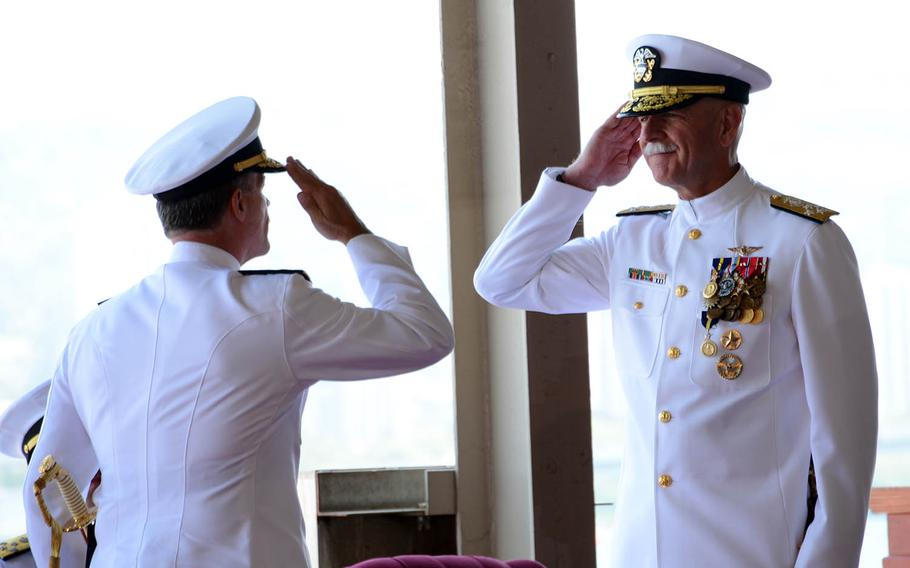 Adm. Scott Swift, right, turns over command of U.S. Pacific Fleet to Adm. John Aquilino during a ceremony at Joint Base Pearl Harbor-Hickam, Hawaii, May 17, 2018.