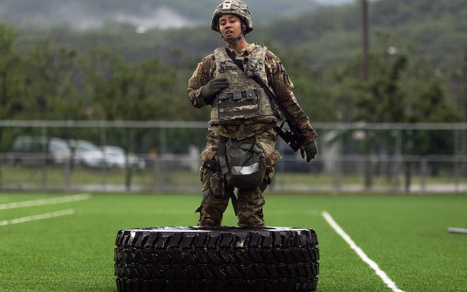 Pfc. Samera Taylor of the 1st Signal Brigade rests after flipping a tire during Eighth Army's Best Warrior competition at Camp Casey, South Korea, Thursday, May 17, 2018.