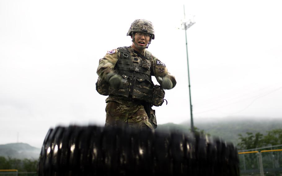 South Korean Sgt. Kim Young Han of Headquarters Eighth Army flips a tire during Eighth Army's Best Warrior competition at Camp Casey, South Korea, Thursday, May 17, 2018.