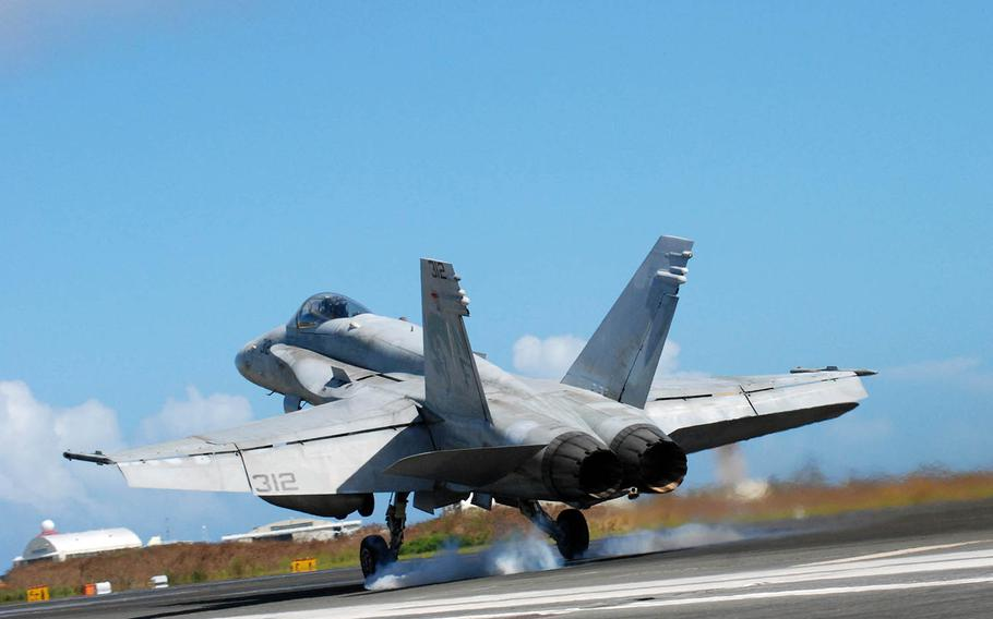 An F/A-18E Super Hornet touches down during past field carrier-landing practice on Iwo Jima, an island known in Japan as Iwo To.
