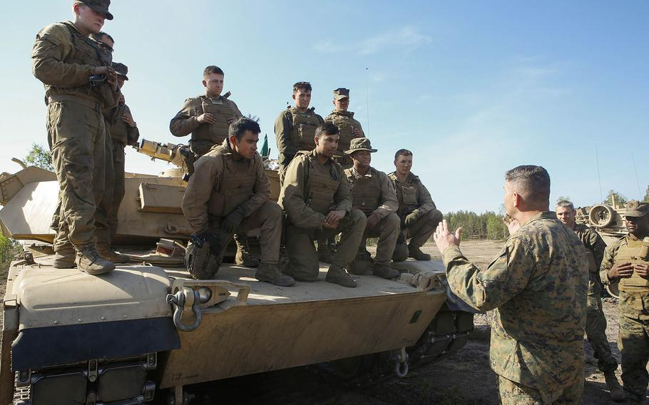 Col. John J. Carroll, the deputy commander of Marine Forces Europe and Africa, talks to Marines with 2nd Platoon, Company B., 4th Tanks from the state of Washington during Exercise Arrow 18 in Pohjankangas Training Area, Finland, May 15, 2018.