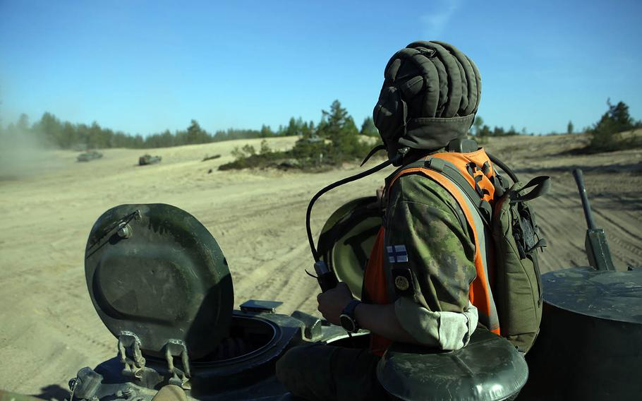 A Finnish soldier overlooks training in Pohjankangas Training Area, Finland, as part of Exercise Arrow 18 on April 15, 2018. Finnish soldiers and U.S. Marines ran drills to find and engage targets with tanks.