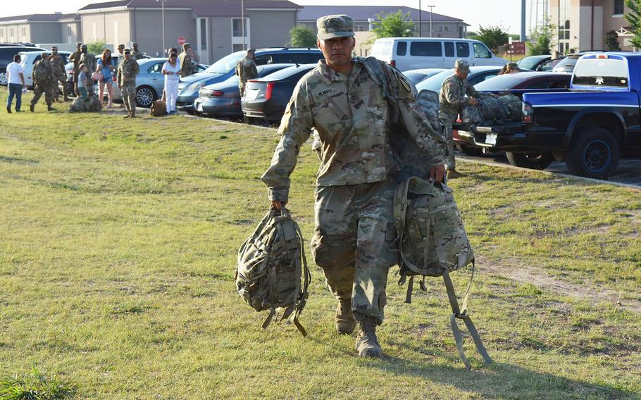 Pfc. Darrell Planas carries his bags at Fort Hood as he prepares to deploy with 1st Brigade Combat Team, 1st Cavalry Division on May 19, 2018. The brigade will spend nine months in Europe as part of Operation Atlantic Resolve.