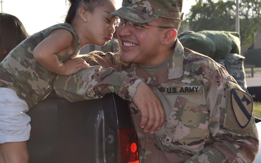 Aubrilyna Alvarez, 3, leans in to kiss her uncle Pfc. Raymond Castillo at Fort Hood on May 19, 2018. The soldier's family surrounded him for goodbyes as he prepared to deploy with 1st Brigade Combat Team, 1st Cavalry Division to Europe from nine months to Europe as part of Operation Atlantic Resolve.