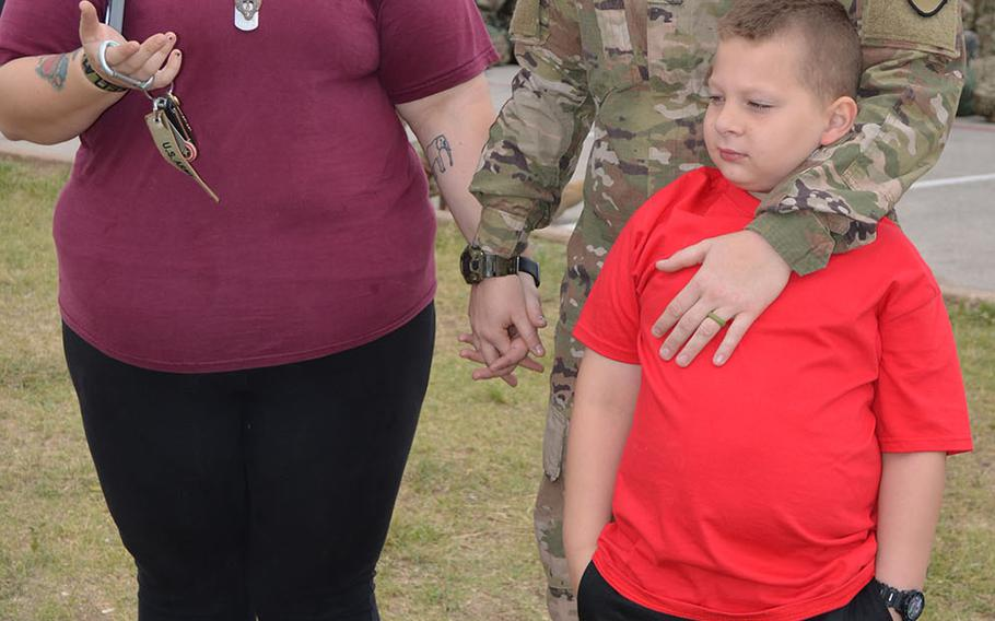 Taylor Kellam, her spouse Pfc. AJ Kellam and their 7-year-old son Larry prepare to say goodbye at Fort Hood on May 19, 2018. The soldier deployed with 1st Brigade Combat Team, 1st Cavalry Division for a nine-month rotation in Europe as part of Operation Atlantic Resolve.