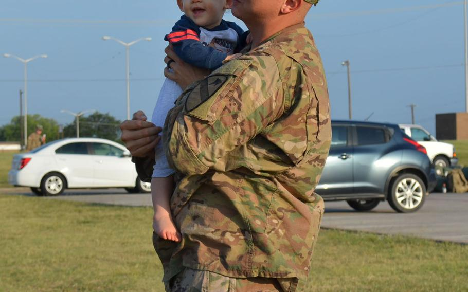 U.S. Army Staff Sgt. John Meyer holds his 1-year-old son Wade as he prepares to deploy to Europe with Fort Hood's 1st Brigade Combat Team, 1st Cavalry Division on May 19, 2018. The brigade will spend nine months participating in Operation Atlantic Resolve.
