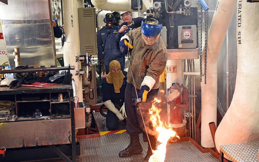 Petty Officer 3rd Class Leonard Barnes prepares to light the One Bravo boiler aboard the USS Blue Ridge at Yokosuka Naval Base, Japan, Tuesday, May 22, 2018.