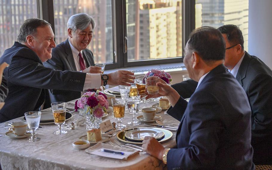 Secretary of State Mike Pompeo, left, toasts North Korean officials, including Vice-Chairman of the Central Committee Kim Yong Chol, in New York City, May 30, 2018.