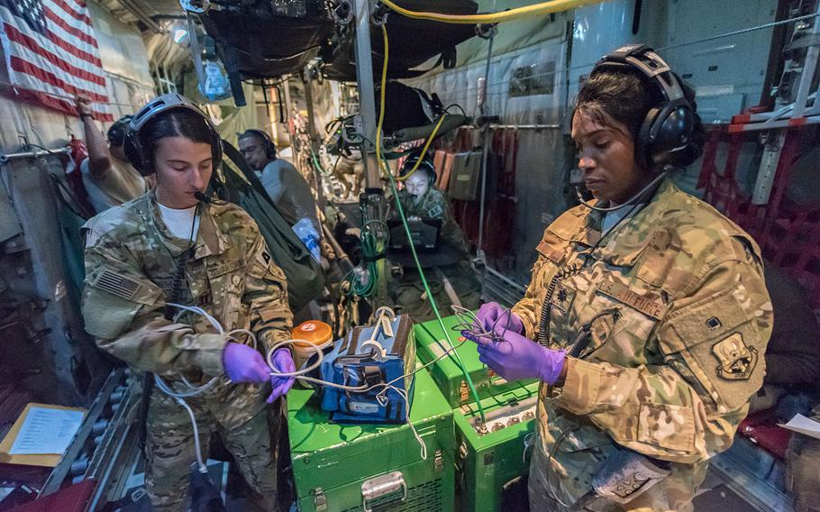 U.S. Air Force Lt. Col. Deveril Wint, right, medical crew director, and Capt. Elise Cunningham, a flight nurse, both with the 379th Expeditionary Aeromedical Evacuation Squadron, pack equipment after a mission to pick up patients in Afghanistan, at Al Udeid Air Base, Qatar, Nov. 25, 2017.