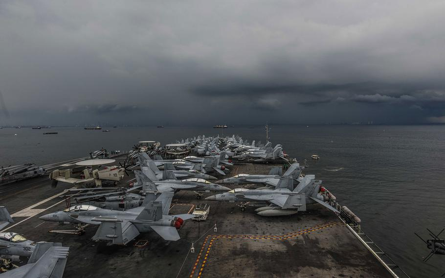 The USS Ronald Reagan sails along the coast of the Philippines in the Philippine Sea on its way to a port visit in Manila on Tuesday, June 26, 2018.