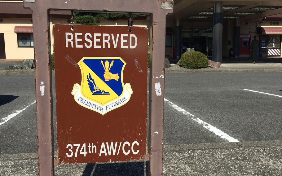 A sign denoting the wing commander's reserved parking space is usually only hung when the wing commander has official business at the Enlisted Club.