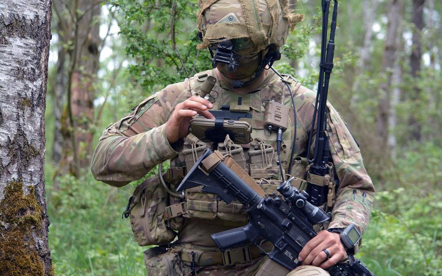 First Lt. Michael Austin, platoon leader for Attack Co., 1-503rd Infantry Regiment, 173rd Airborne Brigade, reports information to his company commander through the Integrated Tactical Network during a live-fire exercise in Grafenwoehr, Germany, May 2, 2018.