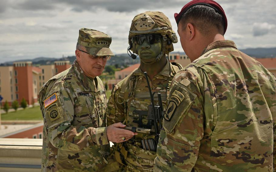 Gen. Curtis Scaparrotti, head of United States European Command, looks at the Integrated Tactical Network System worn by 173rd Airborne Brigade's Spc. Jamal Hersey, in Vicenza, Italy, June 22, 2018.