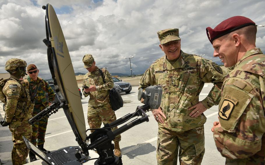 Staff Sgt. Don Leroy, right, assigned to the 173rd Airborne Brigade, shows Gen. Curtis Scaparrotti, commander of U.S. European Command, the Integrated Tactical Network system at Vicenza, Italy, June 22, 2018.