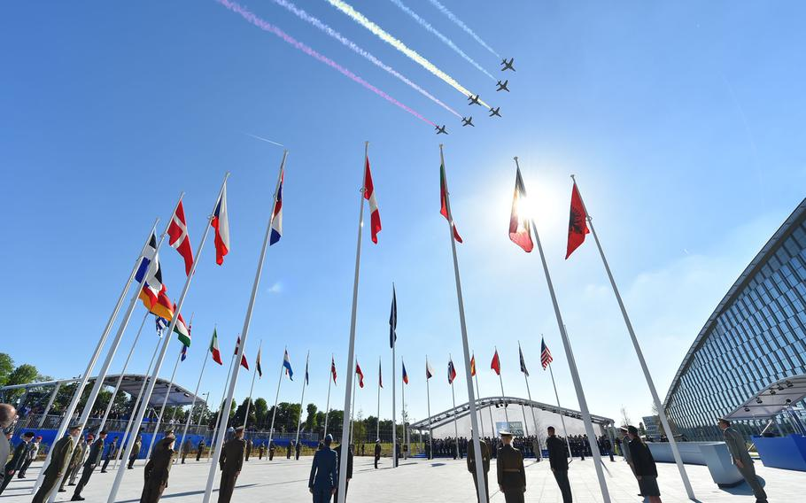 Jets do a flyover at the new NATO headquarters handover ceremony during last year's meeting of NATO heads of state and government in Brussels. Next week, heads of state will again gather in Brussels for a major summit.