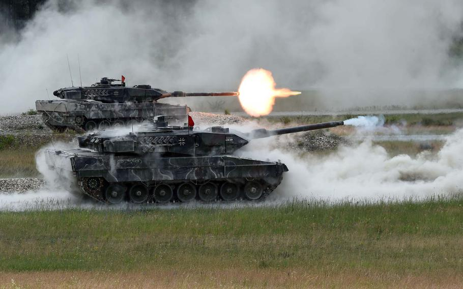 A German tank team fires at targets from its Leopard 2A6 tanks during the Strong Europe Tank Challenge in Grafenwoehr, Germany, Friday, June 8, 2018. President Donald Trump criticized NATO partners, singling out Germany, for not carrying their share of the alliance's costs.
