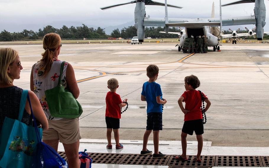 Families wait for their loved ones on MV-22B Ospreys assigned to Marine Medium Tiltrotor Squadron 363 to disembark after arriving at Marine Corps Air Station Kaneohe Bay, Hawaii, July 7, 2018.