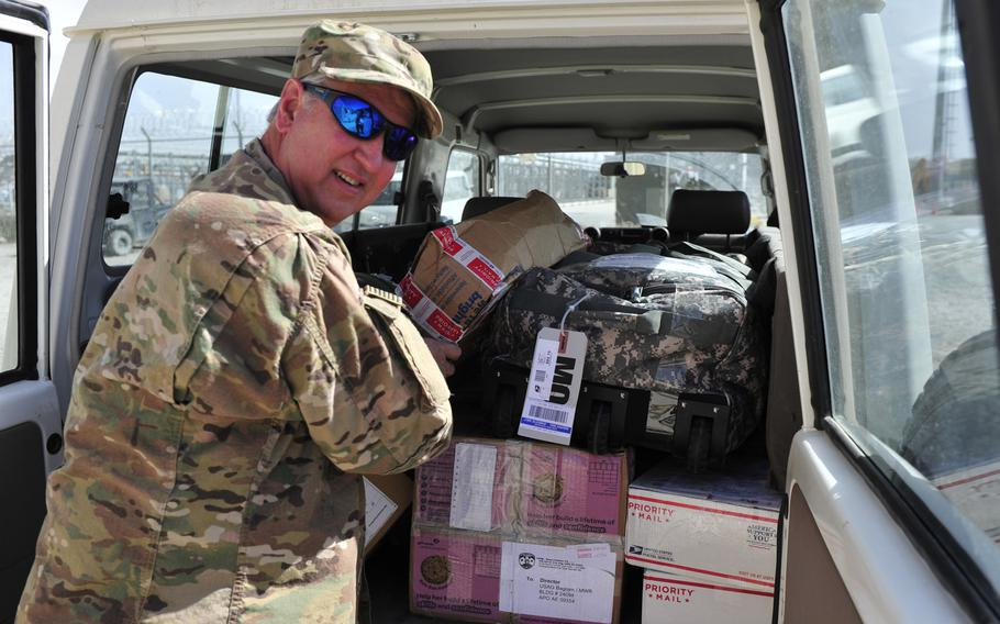 In a 2016 file photo, Eric Longenbach, a human resources specialist with the Bagram Support Group, picks up the mail as part of his additional duties. Longenbach volunteered with the Defense Department's Civilian Expeditionary Workforce to do a tour in Afghanistan. The military is struggling to convince  civilians to work in Afghanistan, according to a memo issued by Defense Secretary Jim Mattis.