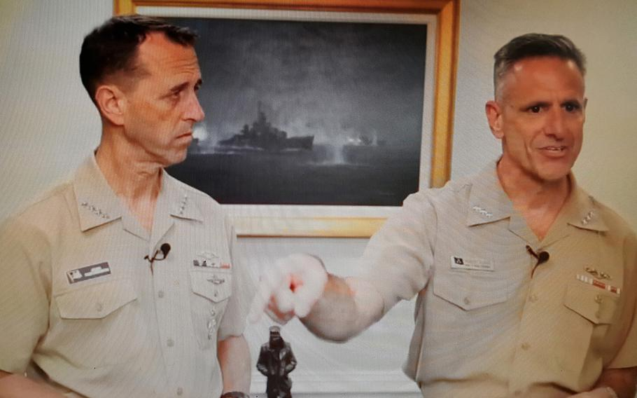 Adm. Robert Burke, right, chief of Navy personnel, talks during a Facebook livestream all-hands call July 10, 2018, while Chief of Naval Operations Adm. John Richardson stands beside him.