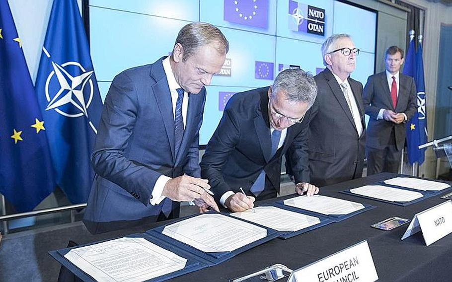 Donald Tusk, left, president of the European Council, and NATO Secretary-General Jens Stoltenberg sign a joint declaration on cooperation between NATO and the European Union on July 10, 2018. The following day, President Donald Trump began the first day of a NATO summit by blasting allies for not contributing enough spending.