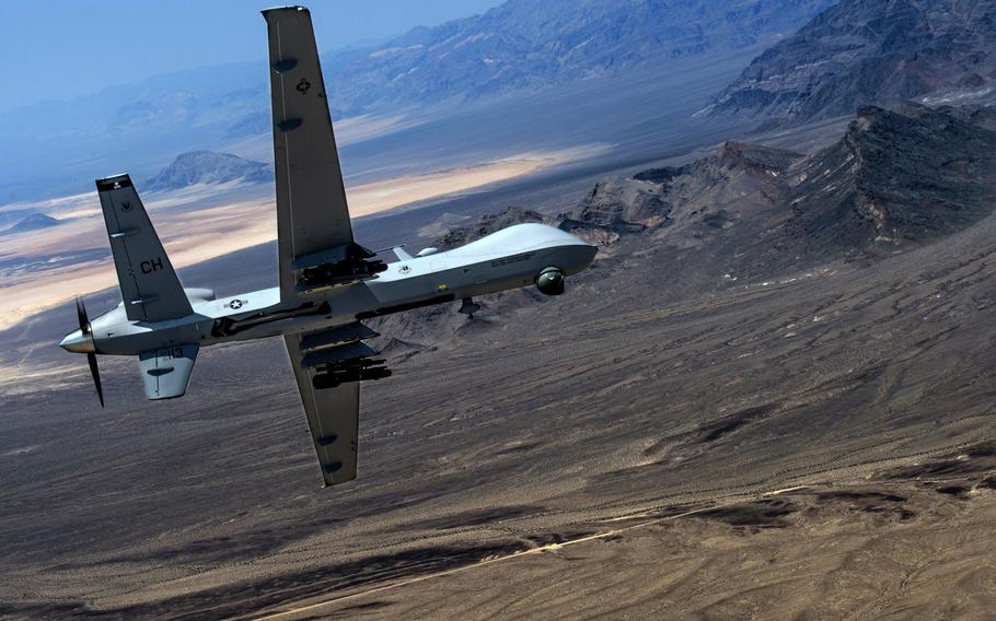 An MQ-9 Reaper remotely piloted aircraft performs aerial maneuvers over Creech Air Force Base, Nev., June 25, 2015. The Reaper is employed primarily as an intelligence-collection asset and secondarily against dynamic execution targets. A hacker recently posted documents related to the drones for sale on the dark web.