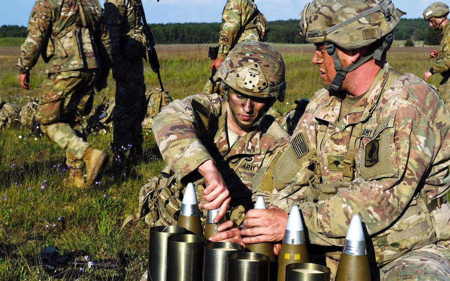 Paratroopers with the 173rd Brigade Combat Team get artillery rounds ready for an artillery live-fire exercise at Grafenwoehr, Germany, Friday, May 18, 2018. A YouGov survey has found that a plurality of Germans want U.S. troops to withdraw from the country.
