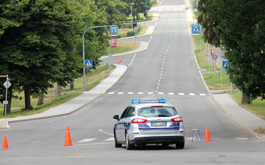 A police car guards a street on a cordoned off area near Smith Barracks on U.S. Army Garrison Baumholder on the afternoon of July 12, 2018 after a construction crew found an unexploded bomb while digging up water lines on the base.
