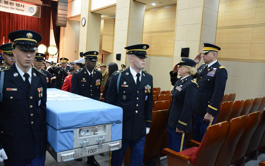 """Soldiers bear a casket containing the remains of a U.N. soldier killed during the 1950-53 Korean War in the """"heroes procession"""" during a repatriation ceremony at the National Cemetery in Seoul, South Korea, on Friday, July 13, 2018."""