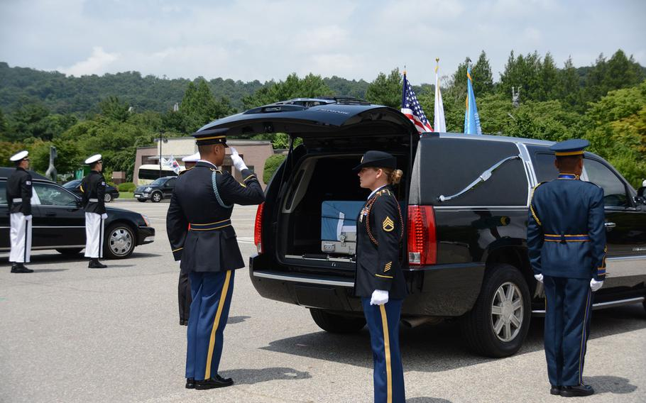 A soldier salutes after loading a casket containing the remains of a U.N. soldier killed during the 1950-53 Korean War into a hearse following a repatriation ceremony at the National Cemetery in Seoul, South Korea, on Friday, July 13, 2018.