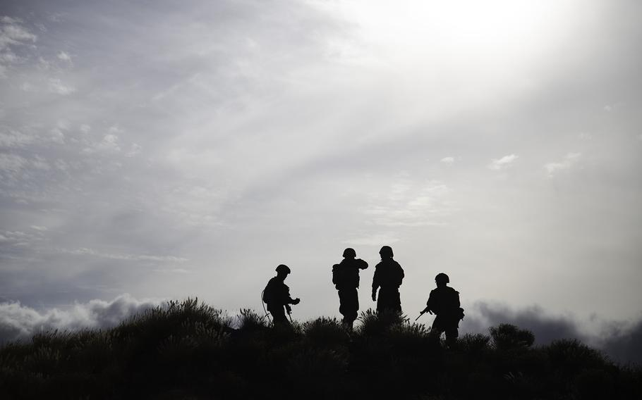 Marines secure a hill at Pohakuloa Training Area, Hawaii, Friday, July 13, 2018.