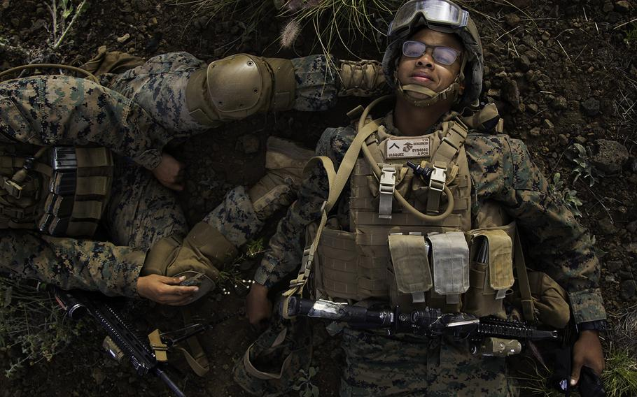 A Marine uses his buddy's foot as a pillow to get in a few extra minutes of rest at Pohakuloa Training Area, Hawaii, Friday, July 13, 2018.