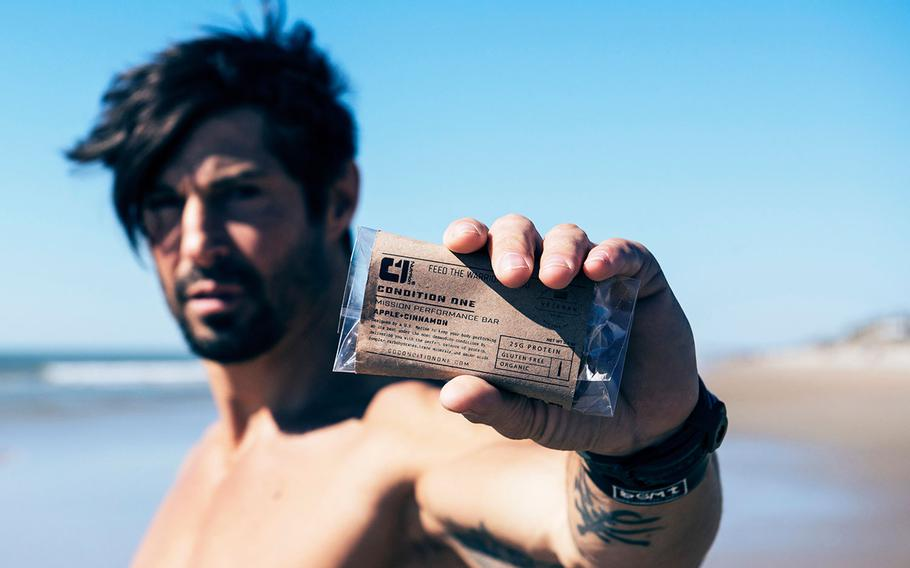 """Actor, martial artist and Marine veteran Rudy Reyes, star of HBO's """"Generation Kill,"""" poses with a Condition One meal-replacement bar."""