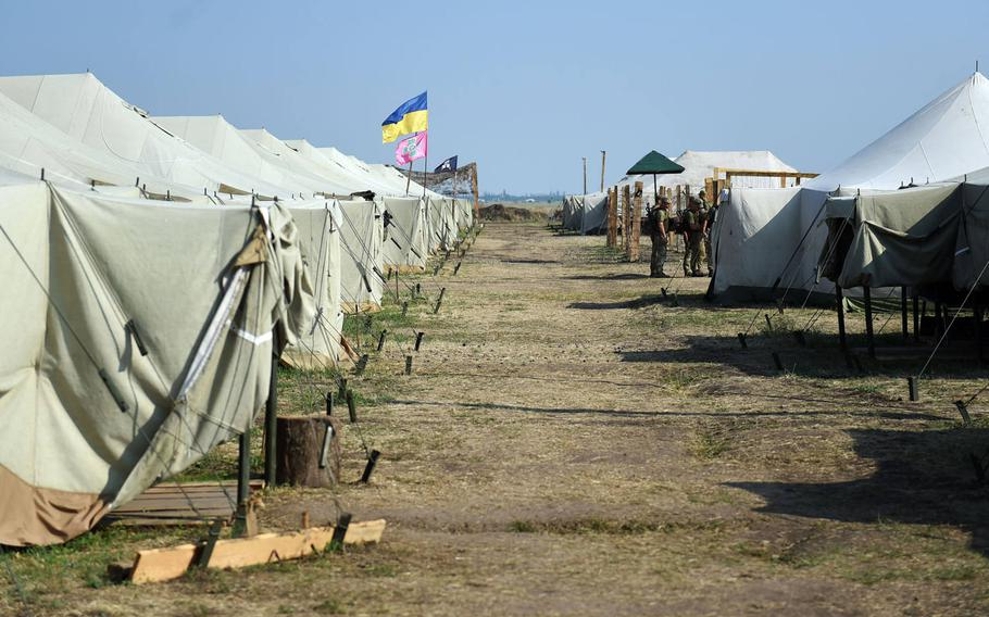 The camp where U.S. Marines and Ukrainian troops are sleeping during exercise Sea Breeze in Ukraine, Wednesday, July 11, 2018. After hours, the servicemembers from each nation turn the area between these tents into a bazaar, where they barter souvenirs and snacks from each other.