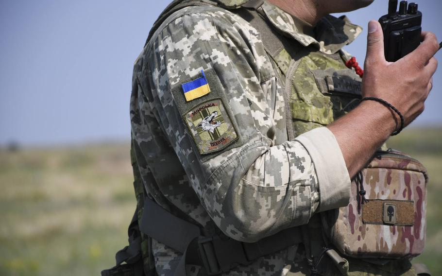 Patches of a Ukrainian flag, a marine corps symbol and a ''Punisher'' skull are pictured here on the uniform of a Ukrainian marine officer participating in exercise Sea Breeze at a base outside the Ukrainian city of Mykolaiv on Thursday, July 12, 2018. U.S. Marines said they were trading their own uniform items and food from their Meals, Ready to Eat in exchange for such patches and other souvenirs.