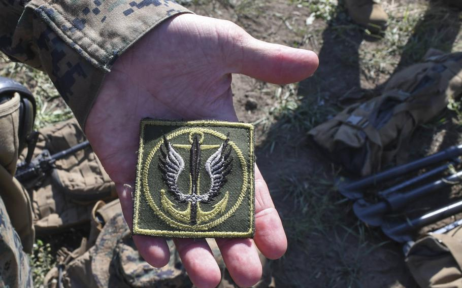 Pictured here at an assembly area where U.S. Marines and their Ukrainian counterparts were set to mount a company attack on Saturday, July 14, 2018, Sgt. Chad Sparks of Hanover, Pa., displays a patch with the insignia of the Ukrainian naval infantry that he traded with Ukrainian counterparts for during the large-scale Sea Breeze exercise.
