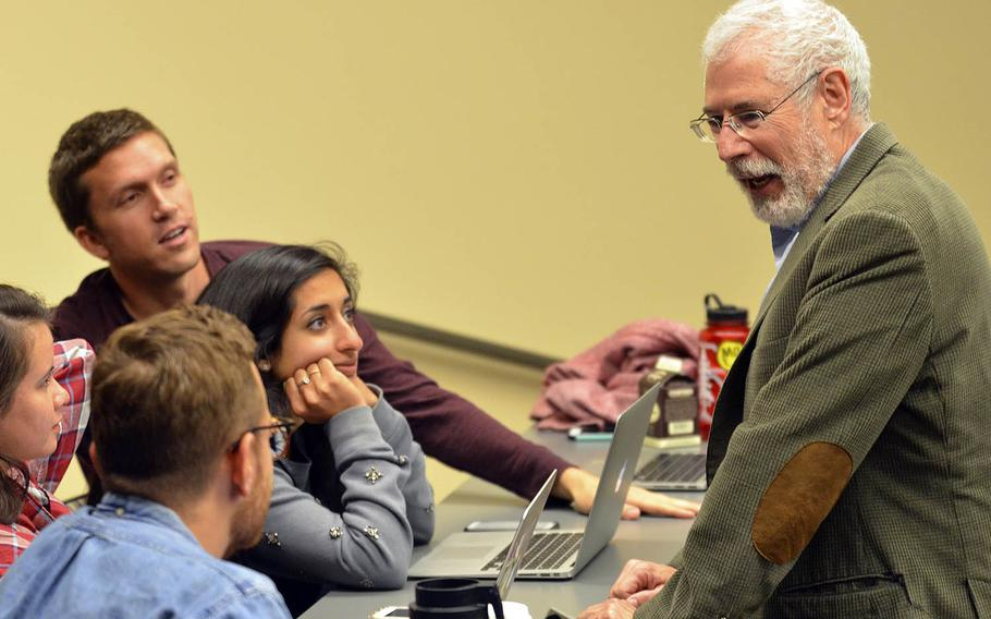 Steve Blank talks with students in Stanford University's first Hacking for Defense class in the spring of 2016. The course will be offered at 22 universities in the coming year.