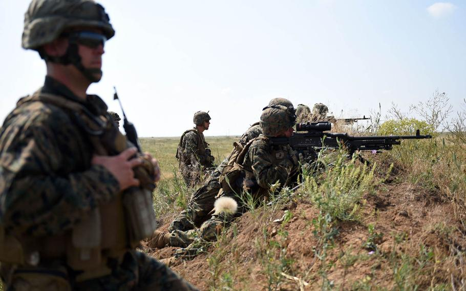 A group of U.S. Marines with the 2nd Battalion, 25th Marine Regiment, engages targets while training with Ukrainian marines during the Sea Breeze exercise near Mykolaiv, Ukraine, Thursday, July 12, 2018.