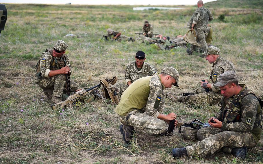Ukrainian Marines load ammunition before live-fire training with U.S. Marines at the Sea Breeze exercise near Mykolaiv, Ukraine, Thursday, July 12, 2018.