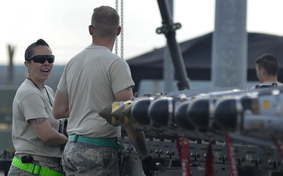 Airmen install guidance systems onto bombs during a combat ammunition production exercise hosted by the 48th Fighter Wing at RAF Lakenheath, England, Tuesday, July 17, 2018. The four-day exercise was the largest of its kind.