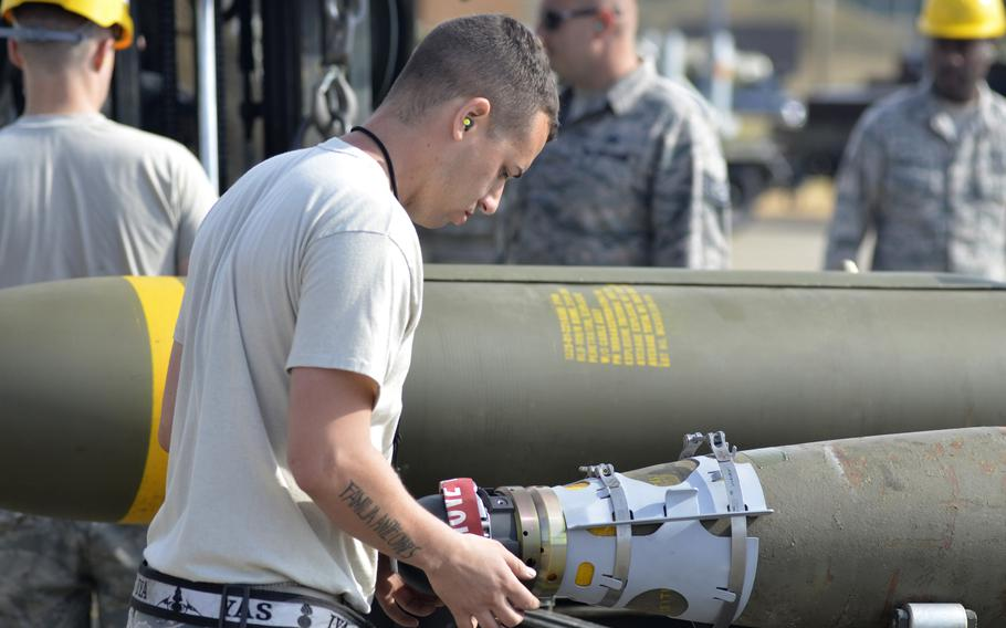 An airman inspects a conventional bomb guidance system during a combat ammunition production exercise hosted by the 48th Fighter Wing at RAF Lakenheath, England, Tuesday, July 17, 2018. Each completed order went through a detailed safety inspection before bombs were delivered to the flight line.