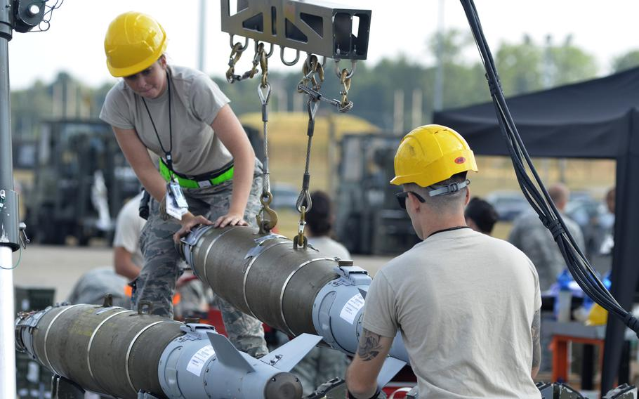 Airmen prepare joint direct attack munitions for flight-line delivery during a four-day combat ammunition production exercise hosted by the 48th Fighter Wing at RAF Lakenheath, England, Tuesday, July 17, 2018. Bombs built during the exercise were broken down into original components and used in new cycles of mass production.