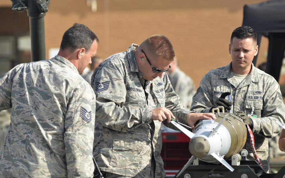 Air Force munitions chiefs inspect a live conventional bomb during a combat ammunition production exercise hosted by the 48th Fighter Wing at RAF Lakenheath, England, Tuesday, July 17, 2018. The four-day exercise was the largest of its kind.