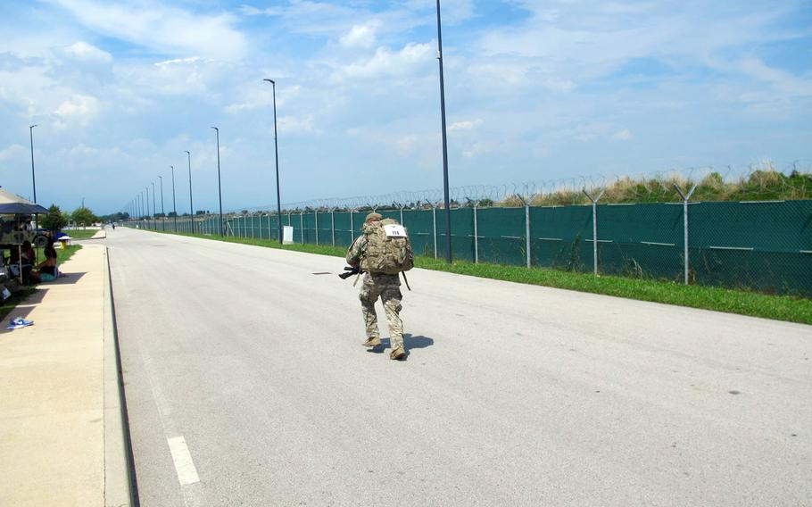 A paratrooper running in the173rd Airborne Brigade's annual memorial relay race, the ''Running of the Herd,'' on July 17, 2018 at Caserma Del Din. Each lap was more than two miles.