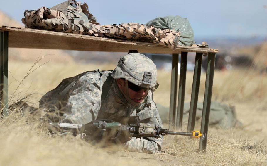 Staff Sgt. Angel Sigetti, infantry squad leader, Headquarters and Headquarters Company, 1st Battalion, 38th Infantry Regiment, 1st Stryker Brigade Combat Team, 4th Infantry Division, moves under simulated direct fire during Expert Infantryman Badge evaluations on March 15, 2016. The Army is planning to revamp evaluations for the badge.