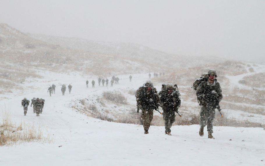 Soldiers of the 4th Infantry Division march 12 miles through a snowstorm during Expert Infantryman Badge evaluations on March 18, 2016. The Army is planning to revamp evaluations for the badge.
