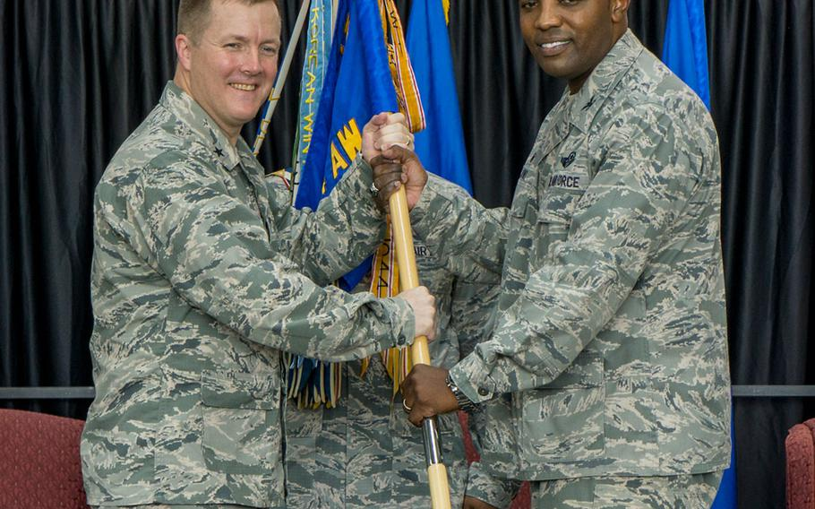 Brig. Gen. Todd Dozier, Fifth Air Force vice commander, left, and Col. Otis Jones, 374th Airlift Wing commander, pause for a photo during the passing of the guidon at Yokota Air Base, Japan, Friday, July 20, 2018.