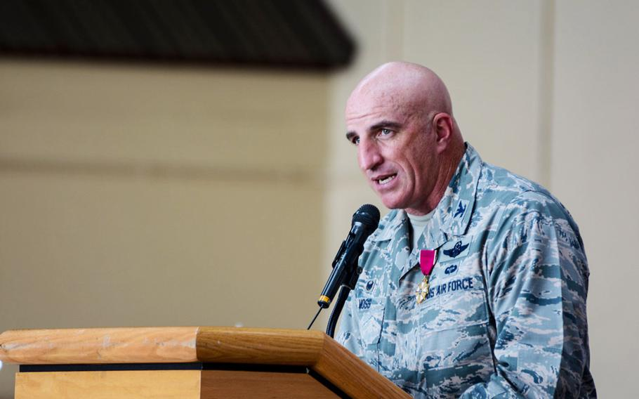 Col. Kenneth Moss, former commander of the 374th Airlift Wing, speaks to the assembled airmen during the 374th's change of command ceremony at Yokota Air Base on Friday, July 20, 2018.