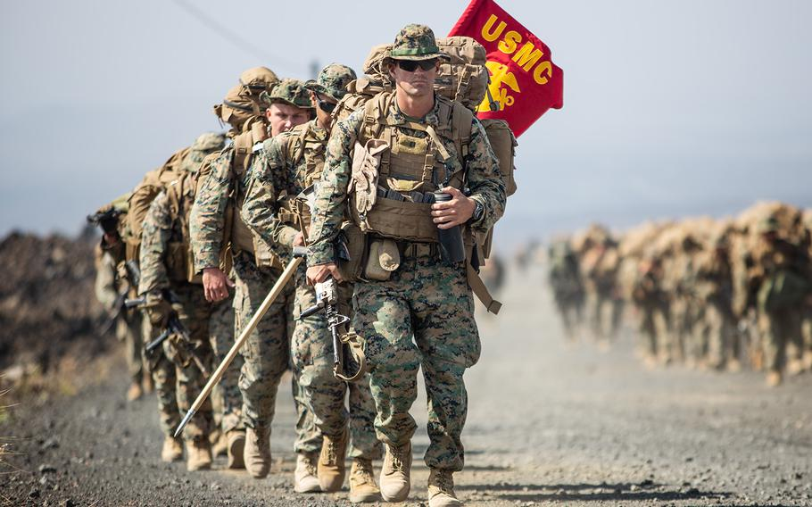 U.S. Marines of Charlie Company, 1st Battalion, 3rd Marine Regiment, march to the next range during Rim of Pacific drills at Pohakuloa Training Area, Hawaii, Sunday, July 15, 2018.