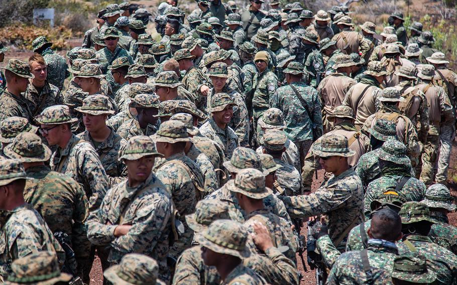 U.S., Chilean, Philippine and South Korean troops await marching orders during the Rim of Pacific exercise at Pohakuloa Training Area, Hawaii, Sunday, July 15, 2018.