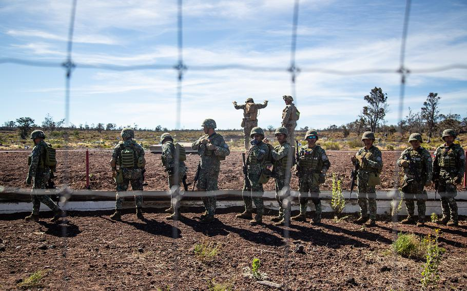 Philippine marines conduct a range with U.S. Marine coaches during the Rim of the Pacific exercise at Pohakuloa Training Area, Hawaii, Monday, July 16, 2018.